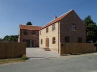 Brick and stone, three-bedroom house with gallery sitting room.